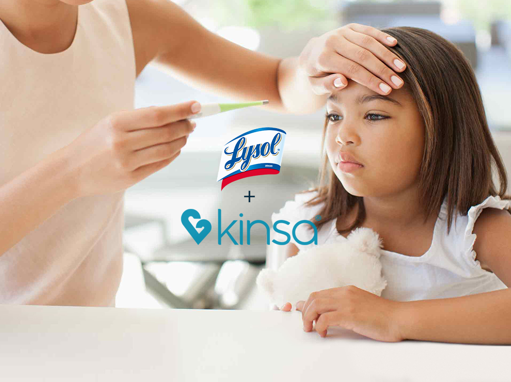 Parent looking at thermometer while holding hand to forehead of unhappy child. The Lysol and Kinsa logos overlay the image.
