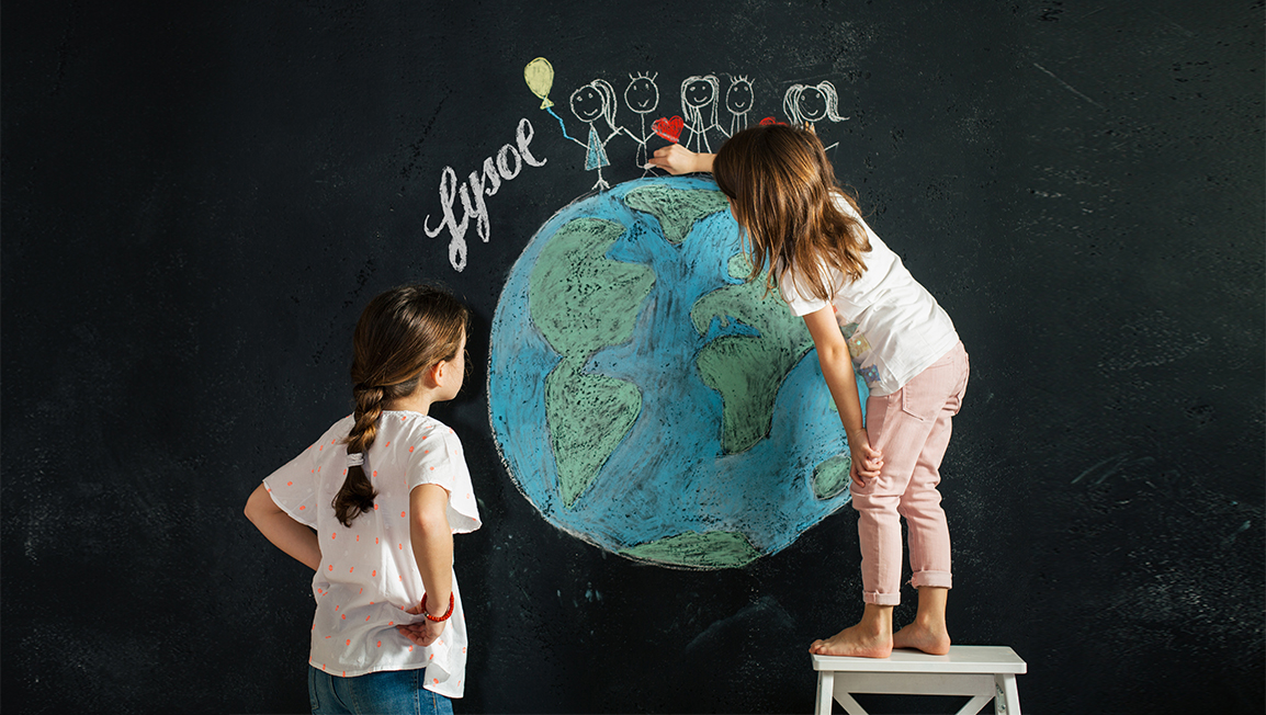 "Children drawing the planet earth on a chalkboard. Stick figures are holding hands and smiling on top of the earth next to the word ""Lysol"""