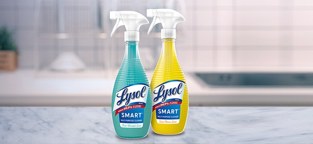 Bottles of Lysol Smart Multi Purpose Cleaner on a kitchen counter. One bottle is Fresh Waterfall Scent. One bottle is Citrus Breeze Scent