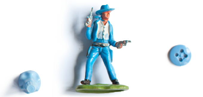 Toy figure of a cowboy wearing a blue suit and blue hat